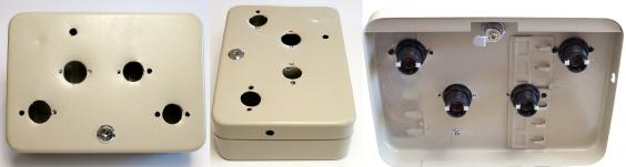 Left: Top-down view of box with four holes drilled for arcade buttons, a smaller hole for the 'Thanks!' light, and a small hole on the side for power. Center: Rotated view of the box, showing the location of the hole for the power cord on the side of the box. Right: View of holes from inside the box with arcade buttons test fitted into place.
